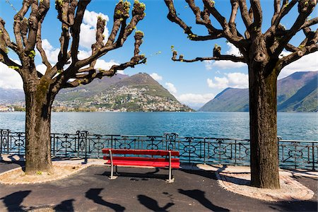 places - Red bench by gnarled plane trees on the promenade in front of Lago Lugano, spring, Switzerland Stock Photo - Rights-Managed, Code: 700-07672099