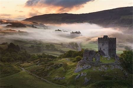 dreamy - Dolwyddelan Castle, Snowdonia National Park, North Wales. Ruined castle in a misty, mountainous landscape at dawn. Stock Photo - Rights-Managed, Code: 700-07672296