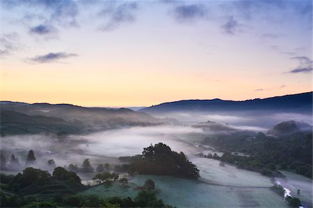 Misty wooded valley at dawn, summer, Snowdonia National Park, North Wales. Stock Photo - Rights-Managed, Code: 700-07672291