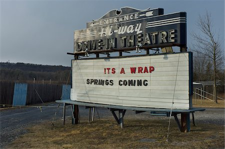 Drive-in Theatre board, closed during winter, along road in Catskills area, New York, USA Stock Photo - Rights-Managed, Code: 700-07698675