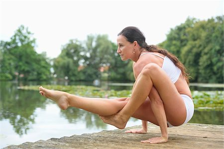 Mature Woman doing Yoga in Park in Summer, Bavaria, Germany Stock Photo - Rights-Managed, Code: 700-07707648