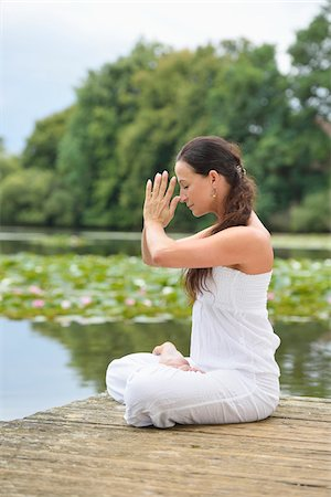 Mature Woman doing Yoga in Park in Summer, Bavaria, Germany Stock Photo - Rights-Managed, Code: 700-07707652