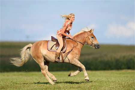 Close-up of a young woman riding a Haflinger horse in summer, Upper Palatinate, Bavaria, Germany Stock Photo - Rights-Managed, Code: 700-07734349