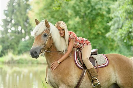 Close-up portrait of a young woman sitting on a Haflinger horse in summer, Upper Palatinate, Bavaria, Germany Stock Photo - Rights-Managed, Code: 700-07734366