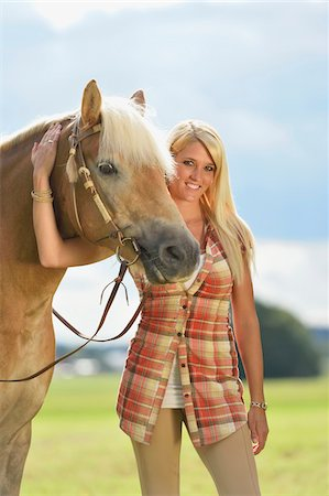 Close-up portrait of a young woman standing beside her Haflinger horse in summer, Upper Palatinate, Bavaria, Gemany Stock Photo - Rights-Managed, Code: 700-07734360