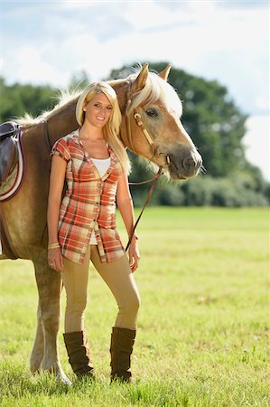 front - Close-up portrait of a young woman standing beside her Haflinger horse in a field in summer, Upper Palatinate, Bavaria, Germany Stock Photo - Rights-Managed, Code: 700-07734363