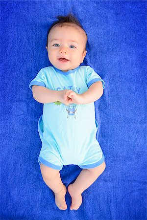 perception - Portrait of three month old baby boy smiling and looking at camera, studio shot on blue background Stock Photo - Rights-Managed, Code: 700-07734406