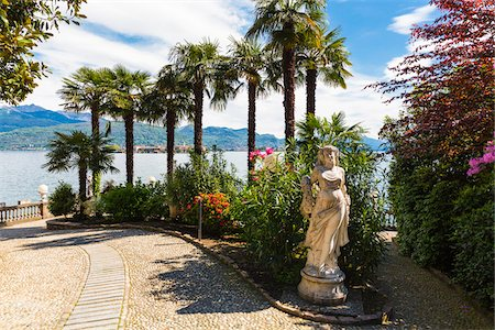 palm - Chinese Hemp Palm Trees (Trachycarpus fortunei) and Statue in Park at Lakefront in Spring, Lago Maggiore, Piedmont, Italy Stock Photo - Rights-Managed, Code: 700-07738639