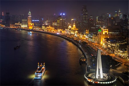 1920's Colonial Buildings beside the Huangpu River at night with People's Heroes Memorial on the bottom right, The Bund, Shanghai, Shanghai Shi, Zhonghua, China Stock Photo - Rights-Managed, Code: 700-07744978