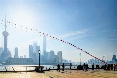 Kite flying along the promenade at The Bund with view of Pudong skyline, Shanghai, Shanghai Shi, Zhonghua, China Stock Photo - Rights-Managed, Code: 700-07744987