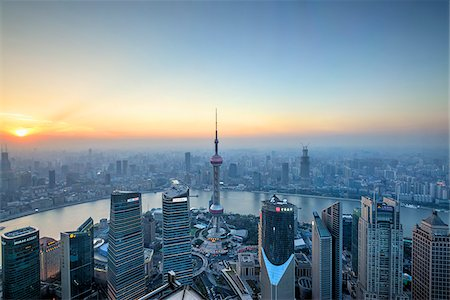 Oriental Pearl Tower and Huangpu River from Jin Mao Tower at Sunset, Lujiazui, Pudong, Shanghai, China Stock Photo - Rights-Managed, Code: 700-07743471