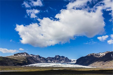 Scenic view of glacier and mountains, Skaftafellsjokull, Skaftafell National Park, Iceland Stock Photo - Rights-Managed, Code: 700-07760089