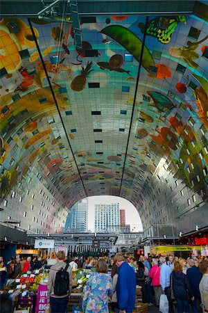 Interior of new Markthal Rotterdam with modern artwork on ceiling. The center of the market space is covered with a structure of residential apartments, Rotterdam, Netherlands Stock Photo - Rights-Managed, Code: 700-07783658