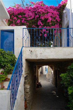 quaint house - View of passage over alley stairs with bougainvillea flowers in mountain village, Greece Stock Photo - Rights-Managed, Code: 700-07783672