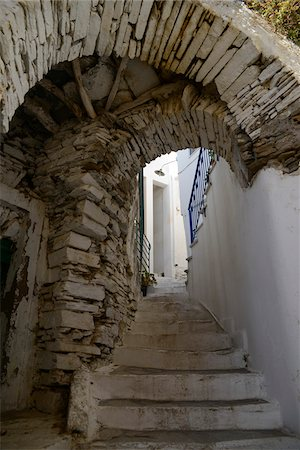 Low angle view of passage over alley with stairs and doorway in mountain village, Greece Stock Photo - Rights-Managed, Code: 700-07783673