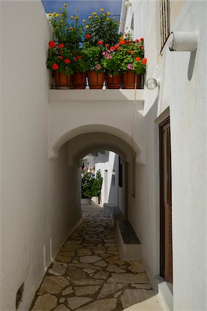 quaint - View of passage way and alley with flowerpots in mountain village, Naxos, Cyclades Islands, Greece Stock Photo - Rights-Managed, Code: 700-07783725