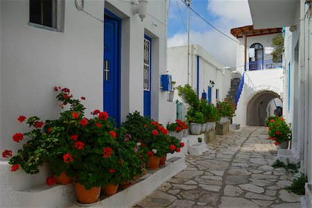 Street scene with houses with blue doors and geranium pots in front, in mountain village, Greece Stock Photo - Rights-Managed, Code: 700-07783726