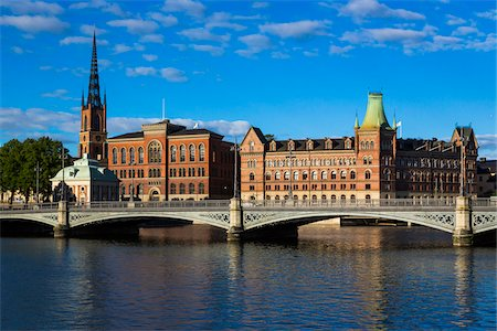 stockholm - Vasa Bridge on the Norrstrom River in front of (from left to right) Riddarholmen Church, Gamla Riksarkivet (Old National Archives Building) and Norstedt Building, Riddarholmen, Stockholm, Sweden Stock Photo - Rights-Managed, Code: 700-07783794