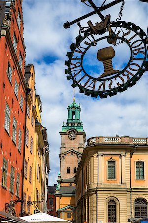 stockholm - Colorful buildings and sign, Stortorget with Stockholm Cathedral (Church of St Nicholas, Storkyrkan (The Great Church) in the background, Gamla Stan (Old Town), Stockholm, Sweden Stock Photo - Rights-Managed, Code: 700-07783811