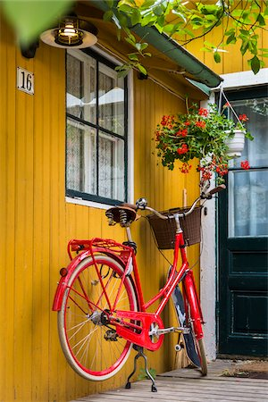 Bicycle parked at entrance of home in Vaxholm near Stockholm, Sweden Stock Photo - Rights-Managed, Code: 700-07783857