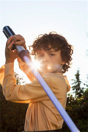 Portrait of Boy with Lightsaber Stock Photo - Rights-Managed, Code: 700-07802827