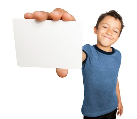 Boy holding a blank card close to camera, studio shot on white background Stock Photo - Rights-Managed, Code: 700-07803085