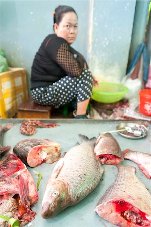 female only - Fish seller at market, Phnom Penh, Cambodia, Indochina, Southeast Asia, Asia Stock Photo - Rights-Managed, Code: 700-07803134