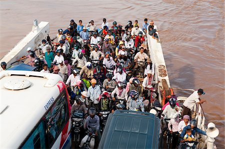 Crowded ferry with passengers and vehicles, Phnom Penh, Cambodia, Indochina, Southeast Asia, Asia Stock Photo - Rights-Managed, Code: 700-07803155