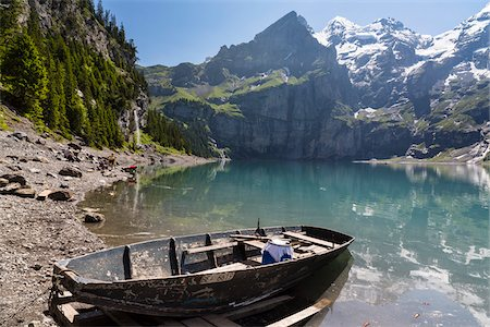 Old rowing boat at the shore of Lake Oeschinensee within the Bernese Alps, mountains above Kandersteg, UNESCO World Heritage Site, Canton of Bern, Switzerland Stock Photo - Rights-Managed, Code: 700-07844374