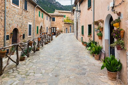 Houses along an alley of the picturesque mountain village Valldemossa, Tramuntana Mountains, Balearic Islands, Spain Stock Photo - Rights-Managed, Code: 700-07849614