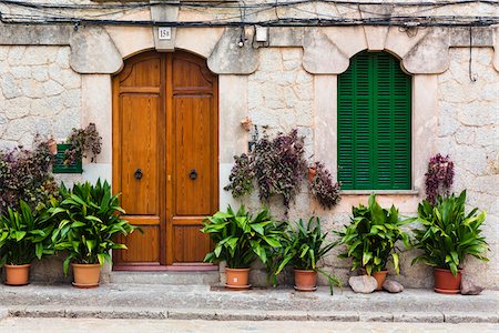 Houses along an alley of the picturesque mountain village Valldemossa, Tramuntana Mountains, Majorca, Balearic Islands, Spain Stock Photo - Rights-Managed, Code: 700-07849613