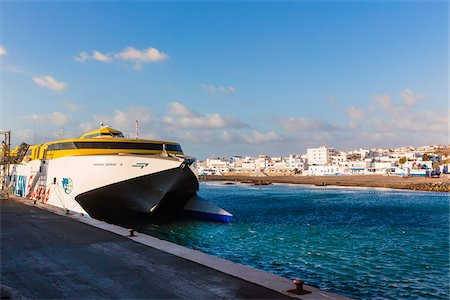 Catamaran ferry (Fred. Olsen) docked in harbour, Agaete, Gran Canaria, Las Palmas, Canary Islands Stock Photo - Rights-Managed, Code: 700-07849649