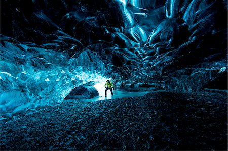 Interior of Ice Cave with Mountain Guide, Iceland Stock Photo - Rights-Managed, Code: 700-07840748