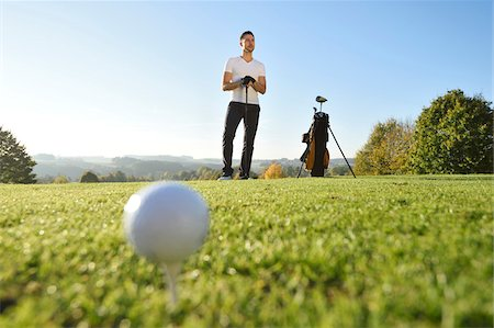 Man Playing Golf on Golf Course in Autumn, Bavaria, Germany Stock Photo - Rights-Managed, Code: 700-07944978