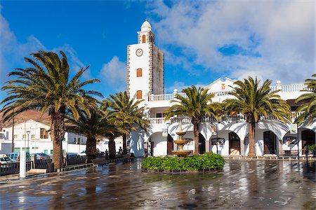 palm - Village church Iglesia de San Martin and palm trees, San Bartolome, Lanzarote, Las Palmas, Canary Islands Stock Photo - Rights-Managed, Code: 700-07945311