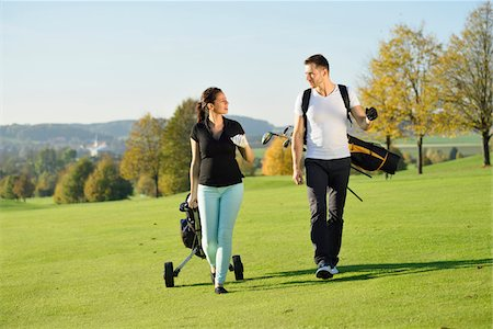 Couple Playing Golf on Golf Course in Autumn, Bavaria, Germany Stock Photo - Rights-Managed, Code: 700-07942522