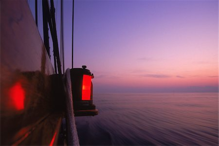 ships at sea - Detail of Port Navigation Running Light at Dawn aboard Schooner, Treee of Life Stock Photo - Rights-Managed, Code: 700-07965867