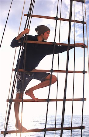 Man Searches for Signs of Sea Life or other Boats while aloft in Ship's Rigging Stock Photo - Rights-Managed, Code: 700-07965863