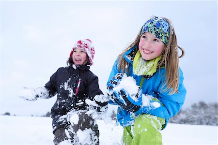 roll (people and animals rolling around) - Close-up of two girls playing in the snow having snowball fight, winter, Bavaria, Germany Stock Photo - Rights-Managed, Code: 700-07991778