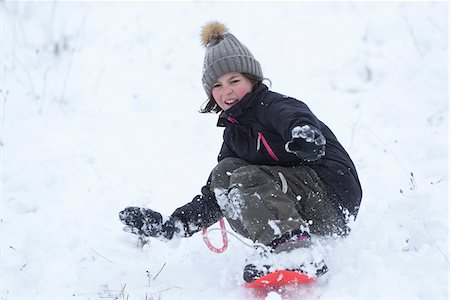 Girl Playing Outdoors in Snow, Upper Palatinate, Bavaria, Germany Stock Photo - Rights-Managed, Code: 700-08002294