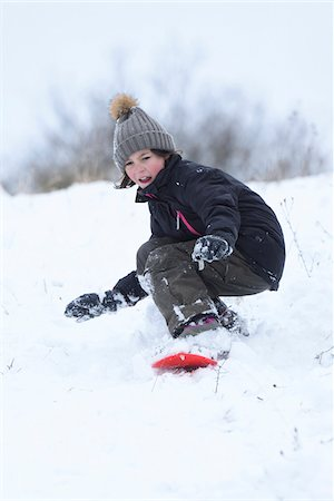 Girl Playing Outdoors in Snow, Upper Palatinate, Bavaria, Germany Stock Photo - Rights-Managed, Code: 700-08002293