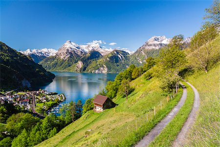small town snow - Alpine Meadow above Village of Sisikon at Tellsplatte at Urnersee in front of Mount Gitschen and Uri-Rotstock still Snow Covered, Canton of Uri, Switzerland Stock Photo - Rights-Managed, Code: 700-08059790