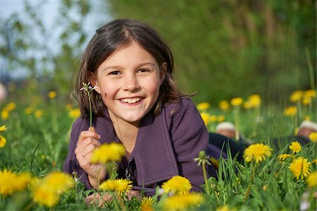 preteen girls faces photo - Close-up of Girl Lying in Meadow in Spring, Upper Palatinate, Bavaria, Germany Stock Photo - Rights-Managed, Code: 700-08059858