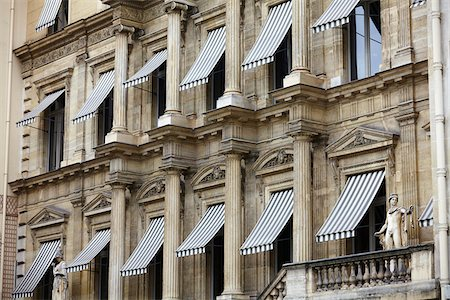 Building with Awnings over Windows, Paris, France Stock Photo - Rights-Managed, Code: 700-08059887