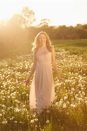 dress - Young woman standing in a withered dandelion meadow in spring, Germany Stock Photo - Rights-Managed, Code: 700-08080548
