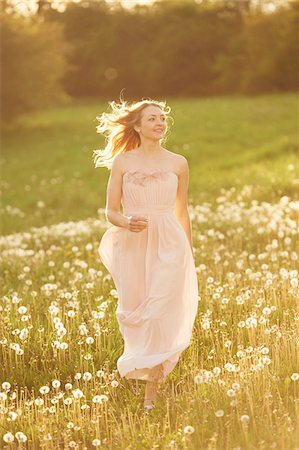dress - Young woman running in a withered dandelion meadow in spring, Germany Stock Photo - Rights-Managed, Code: 700-08080549