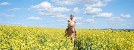 Young woman riding a Haflinger horse in a canola field in spring, Bavaria, Germany Stock Photo - Rights-Managed, Code: 700-08080575