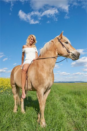 Portrait of young woman sitting on a Haflinger horse in a meadow in spring, Bavaria, Germany Stock Photo - Rights-Managed, Code: 700-08080579