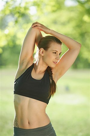 female only - Close-up portrait of a young woman exrecising, stretching in a park in spring, Bavaria, Germany Stock Photo - Rights-Managed, Code: 700-08080570