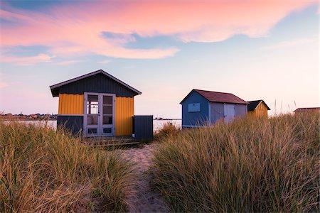 picture - Beach Huts at Grass Covered Sand Dune by Baltic Sea at Dawn, Aero Island, Jutland Peninsula, Region Syddanmark, Denmark Stock Photo - Rights-Managed, Code: 700-08103025